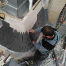 Réalisation d'une abside ardoise sur bandeaux zinc par votre couvreur cordiste à Paris